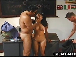 Hot brunette schoolgirl gets spit roasted by two randy dudes
