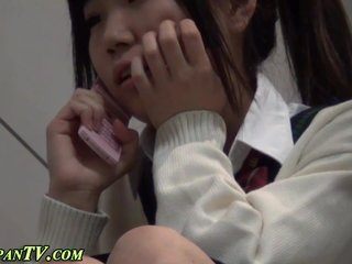 Asian schoolgirl rubs box