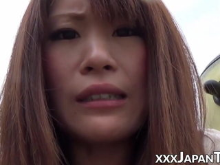 Nice Asian nubile squirts while frigged in public